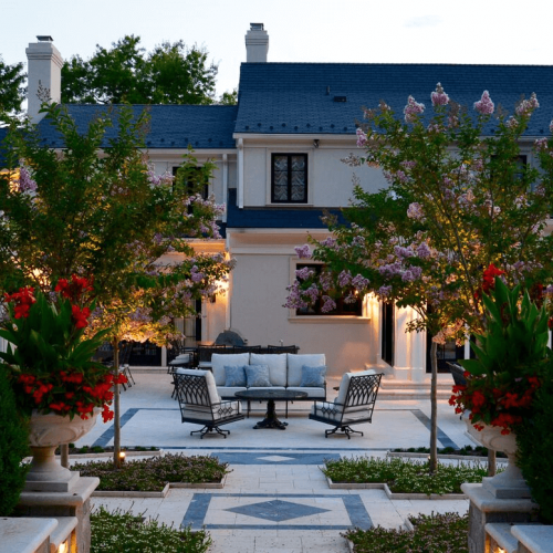 Image of custom stone patio in Potomac, Maryland designed by Capitol Hardscapes.